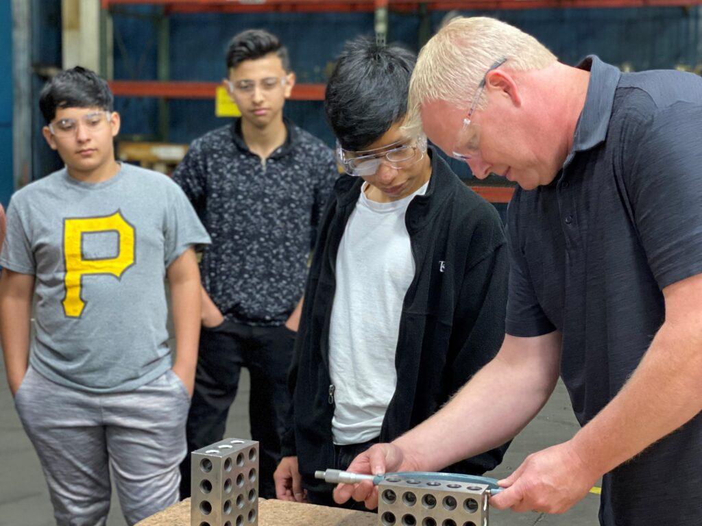 Brilex worker shows kids the equipment